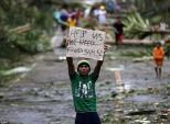 Khung cảnh hoang tàn ở những nơi siêu bão Hagupit quét qua