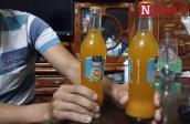Vật thể lạ nổi lập lờ trong chai nước cam của Coca Cola Việt Nam