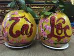 Mãn nhãn trái cây thư pháp độc lạ hút khách dịp Tết
