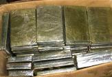 Phát hiện 120 bánh heroin giấu dưới gầm ôtô qua biên giới