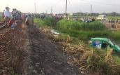 Taxi Mai Linh bị tàu hỏa tông văng xuống ruộng, 2 người thiệt mạng